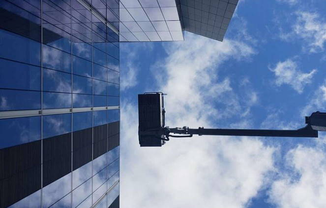 Aerial lift commercial window or facade wash